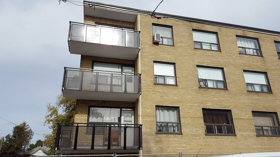 Photo of mesh panel railing on residential building balconies